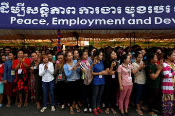 Garment workers welcome Cambodia's Prime Minister Hun Sen during a rally in Kandal province