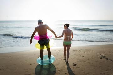Senior friends enjoying the beach in the summertime