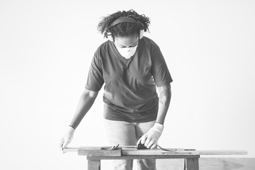 African american woman renovating the house