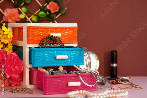 Casket for jewelry, cosmetics and accessories  Bijouterie in a multi