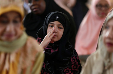 Muslims take part in morning prayers during the first day celebration of Eid al Fitr at a mosque in Bangkok