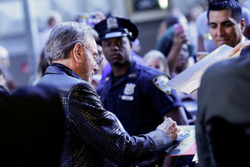 American singer-songwriter Neil Diamond signs records as he arrives for the Songwriters Hall of Fame Awards in the Manhattan borough of New York City, New York