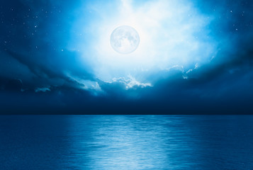 "Night sky with full moon and reflection in sea,  ""Elements of this image furnished by NASA"""