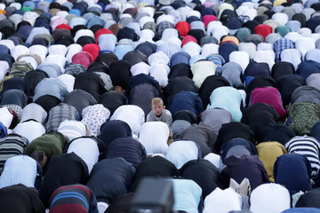 A boy is seen as Albanian Muslims celebrate Eid al Fitr, the end of the holy month of Ramadan, with prayers in Tirana