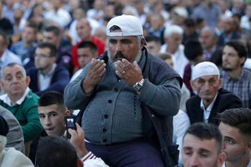Albanian Muslims take a picture before morning prayers during the first day celebration of Eid al Fitr in Tirana