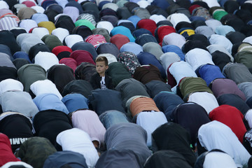 A boy is pictured as Albanian Muslims celebrate Eid al Fitr, the end of the holy month of Ramadan with prayers in Tirana