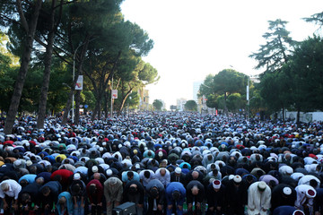 Albanian Muslims perform Eid al-Fitr prayers marking the end of the holy fasting month of Ramadan in Tirana, Albania