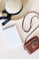 straw hat, camera, notebook