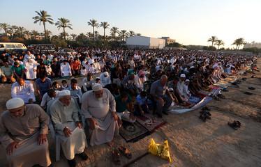 Palestinians perform Eid al-Fitr prayers in Khan Younis in the southern Gaza Strip