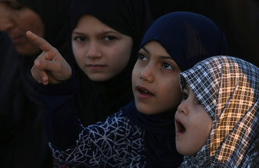 Palestinian girls attend Eid al-Fitr prayers in Khan Younis in the southern Gaza Strip