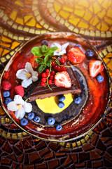chocolate brownie cake garnished with fruit