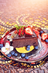 brownie cake garnished with fruit