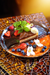 chocolate and nut cake with fruit in the restaurant