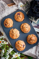 Muffins from whole wheat flour with berries, top view