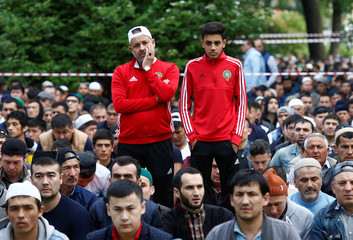 Supporters of the Moroccan national soccer team attend an Eid al-Fitr mass prayer to mark the end of the holy fasting month of Ramadan in Saint Petersburg