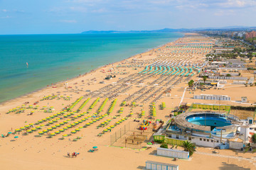 Aerial view of Rimini beach with people and blue water. Summer vacation concept.