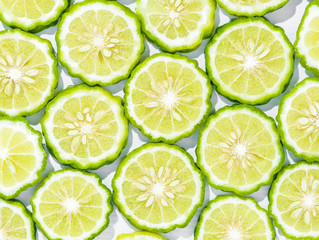 background of Sliced bergamot on white