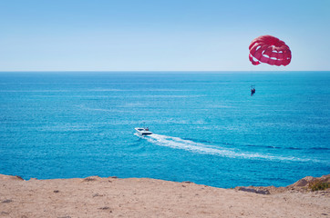 Vibrant image of two people parasailing