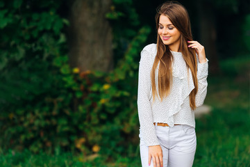 stylish girl in summer clothes that is great for a walk in the park