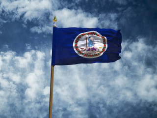 Virginia flag USA flag Silk waving flag made transparent fabric of Virginia US state with wooden flagpole gold spear on background sunny blue sky white smoke clouds real retro photo 3d illustration