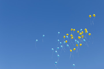 balloons rise to the sky
