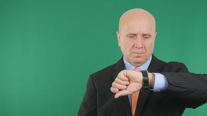 Serious Businessman Image Checking Time on His Hand Watch