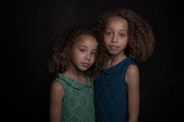 Studio portrait of two sisters