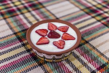 Strawberries arranged in a bowl of yogurt