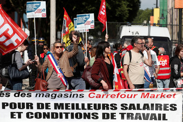 Employees and CGT labour union members demonstrate against Carrrefour's plan to close stores and to cut jobs, in front of the company's headquarters in Aubervilliers