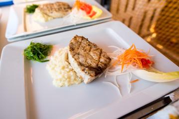 A fish steak dish with potatoes puree