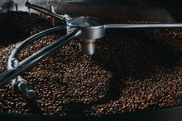 Traditional coffee roaster cooling of fresh roasted coffee beans