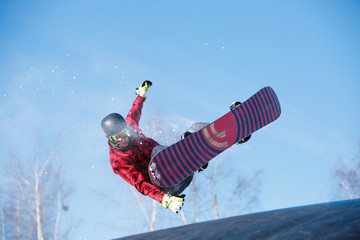 Picture of young athlete jumping with snowboard