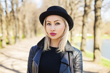 Pretty Female Model Woman in Black Hat in Sunny Day, Outdoors Fashion Portrait