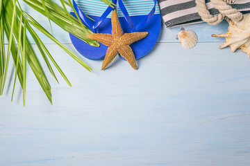 Beach holiday objects on blue wooden background with copy space