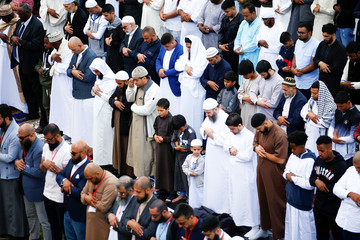 Around 140,000 muslims attend Eid al-Fitr prayers to mark the end of Ramadan, in Small Heath Park in Birmingham