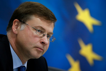Valdis Dombrovskis attend a news conference with Greek Finance Minister Euclid Tsakalotos (not pictured) at the Finance ministry in Athens