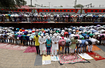 Muslims offer prayers during Jumat-ul-Vida or the last Friday prayers near railway tracks during the holy fasting month of Ramadan, in New Delhi