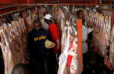 Traders arrange goat meat inside a slaughterhouse after Eid al-Fitr prayers to mark the end of the holy fasting month of Ramadan in Nairobi