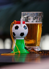 A view shows a horn of a soccer supporter and a glass of beer at a cafe in central Moscow