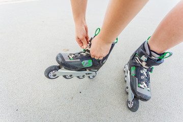 Woman putting roller skates on