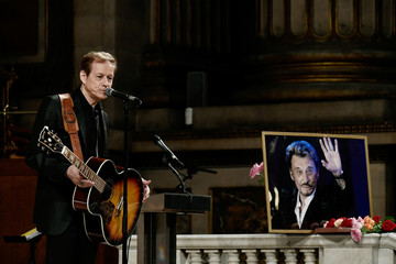 French singer Chris Evans performs during a mass in tribute of the late French singer Johnny Hallyday at the La Madeleine church in Paris