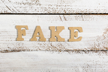 Fake word on white painted table