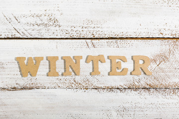 Winter word on white painted table