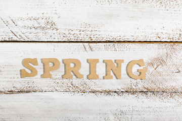 Spring word on white painted table