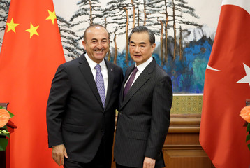 Turkish Foreign Minister Mevlut Cavusoglu and Chinese Foreign Minister Wang Yi attend a joint news conference in Beijing