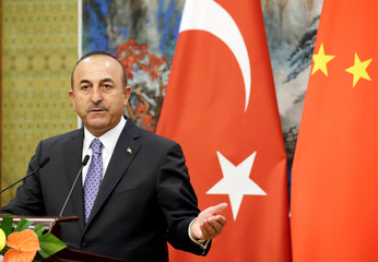 Turkish Foreign Minister Mevlut Cavusoglu attends a joint news conference with Chinese Foreign Minister Wang Yi in Beijing