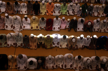 Muslims offer prayers during Jumat-ul-Vida or the last Friday prayers during the holy fasting month of Ramadan, inside a mosque in Allahabad