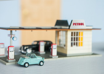 70's petrol station parked with retro cars