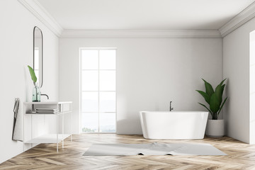 White loft bathroom interior, sink and tub