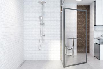Shower in a white brick bathroom